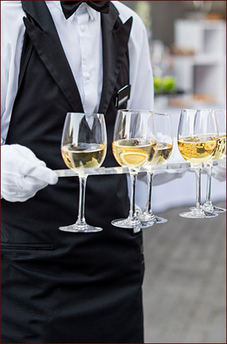 Server with glasses of champagne